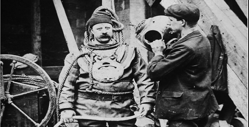 Old diver putting on gear